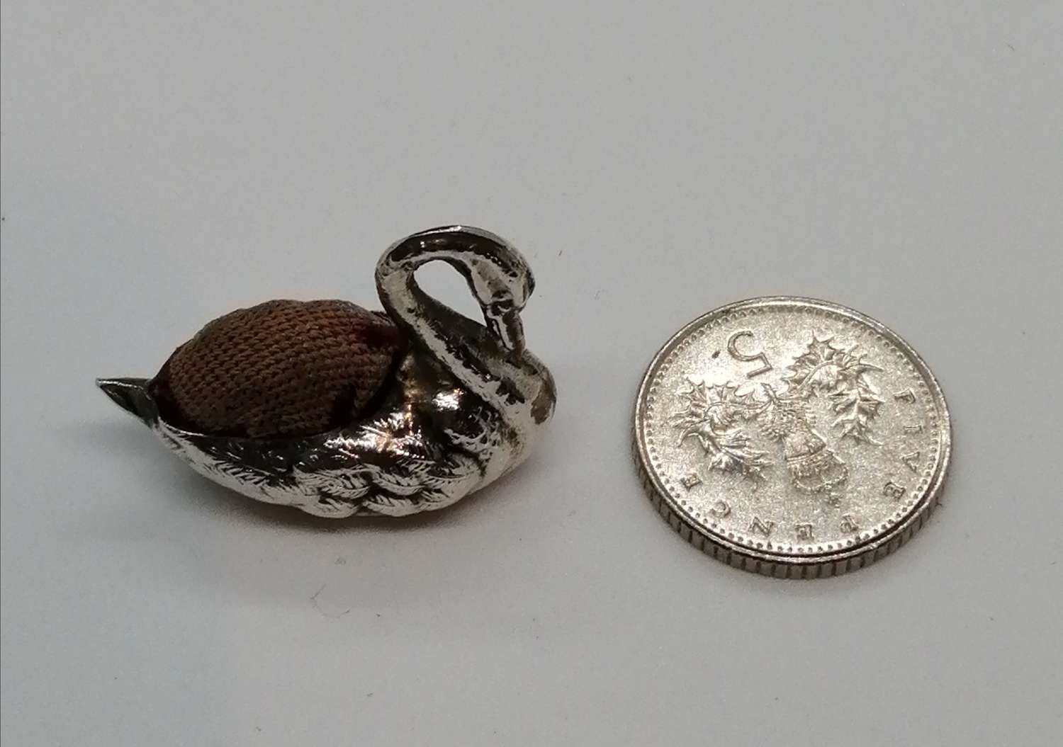 Miniature silver swan pincushion