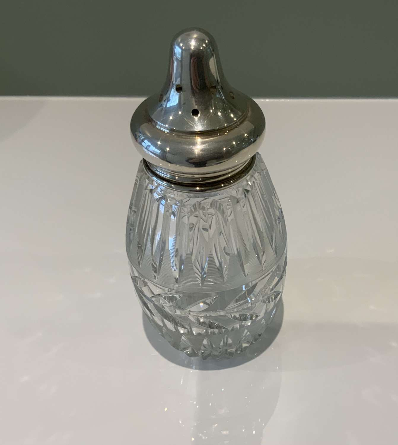 Silver topped glass sugar sifter