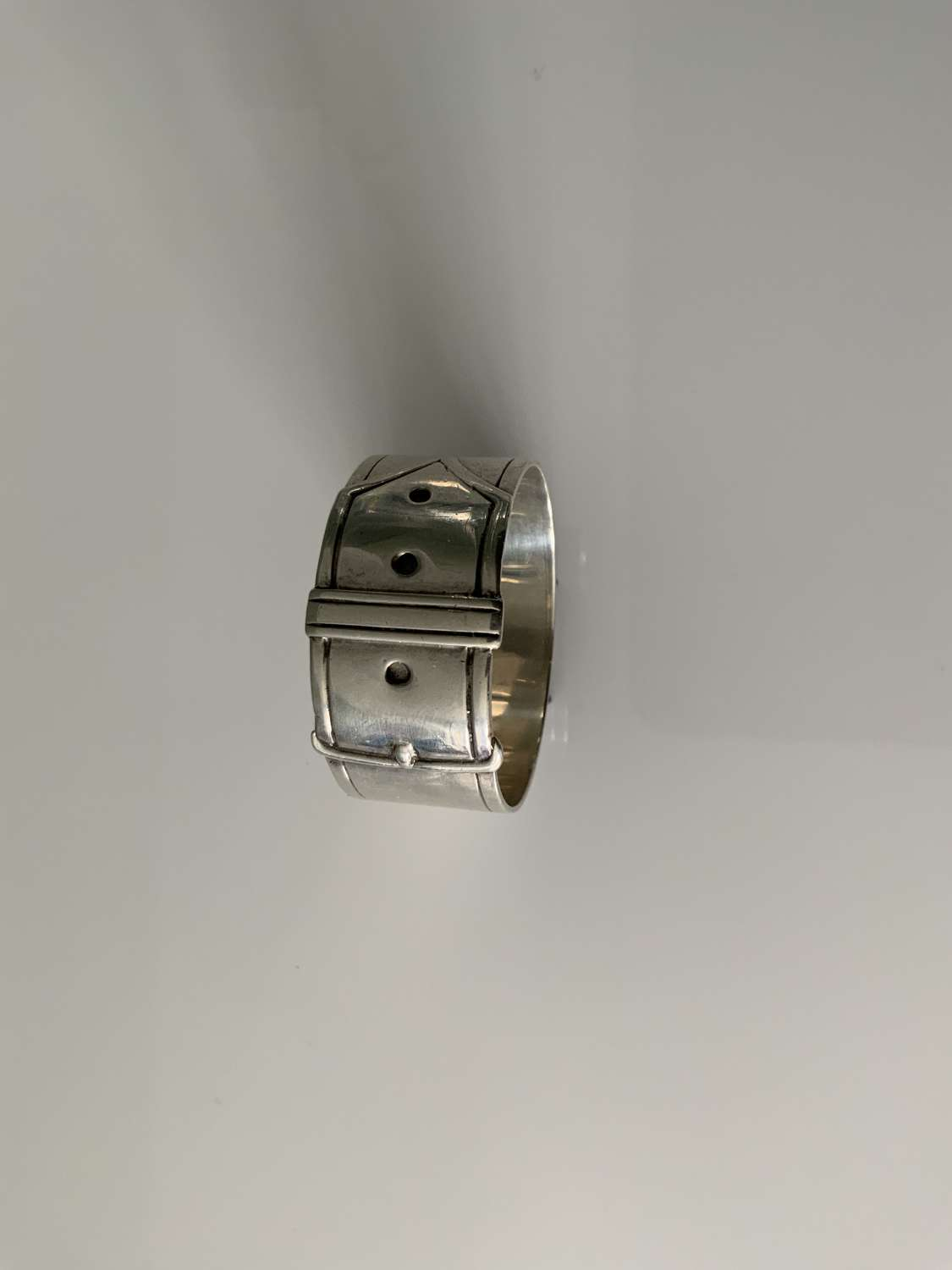 Silver buckle napkin ring
